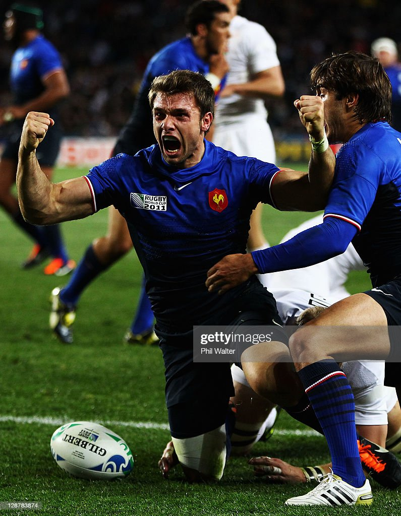 <a gi-track='captionPersonalityLinkClicked' href=/galleries/search?phrase=Vincent+Clerc&family=editorial&specificpeople=235795 ng-click='$event.stopPropagation()'>Vincent Clerc</a> of France celebrates his opening try with Alexis Palisson (R) during quarter final two of the 2011 IRB Rugby World Cup between England and France at Eden Park on October 8, 2011 in Auckland, New Zealand.