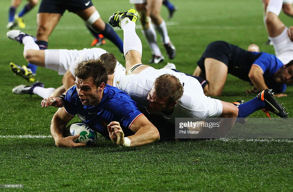 <a gi-track='captionPersonalityLinkClicked' href=/galleries/search?phrase=Vincent+Clerc&family=editorial&specificpeople=235795 ng-click='$event.stopPropagation()'>Vincent Clerc</a> of France goes over to score the opening try during quarter final two of the 2011 IRB Rugby World Cup between England and France at Eden Park on October 8, 2011 in Auckland, New Zealand.
