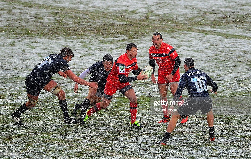 Vincent Clerc of Toulouse takes on Geoff Parling and Adam Thompstone of Tigers during the Heineken Cup match between Leicester Tigers and Toulouse at Welford Road on January 20, 2013 in Leicester, England.