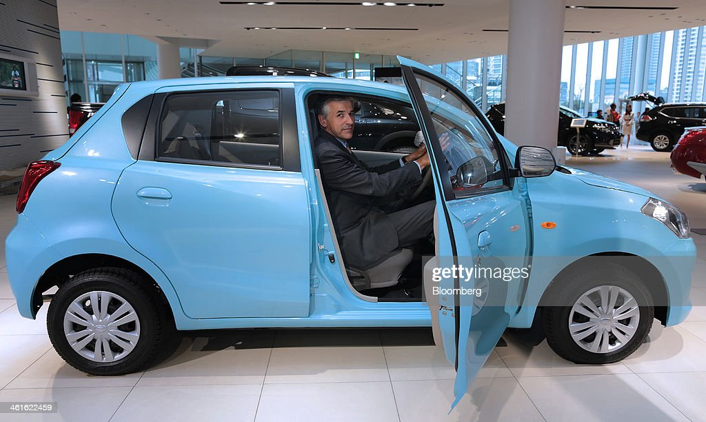 Vincent Cobee, global head for the Datsun brand at Nissan Motor Co., sits in the driver's seat of a Datsun Go automobile as he poses for a photograph at the company's showroom in Yokohama, Japan on Wednesday, Jan. 8, 2014. Nissan said its low-end Datsun business will generate operating margins of as high as 7 percent because of its no-frills designs and by sharing the parents development facilities and distribution network. Photographer: Yuriko Nakao/Bloomberg via Getty Images
