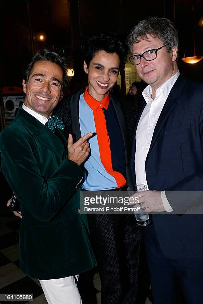 Vincent Darre Farida Khelfa and her husband Henri Seydoux attend Vincent Darre Exhibition opening at Galerie Pierre Passebon on March 19 2013 in...