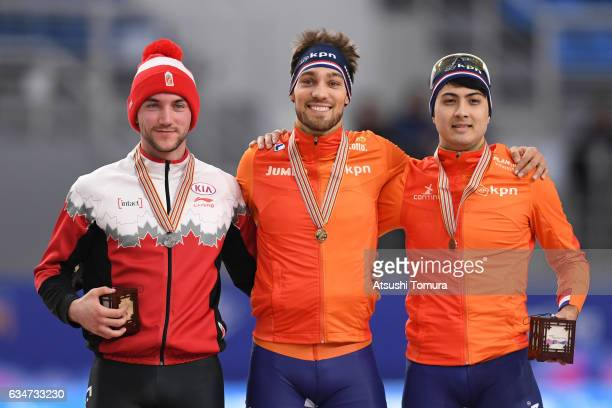 Vincent De Haitre of Canada Kjeld Nuis of Netherlands and Kai Verbij of Netherlands pose with their medals for the men 1000m during the ISU World...