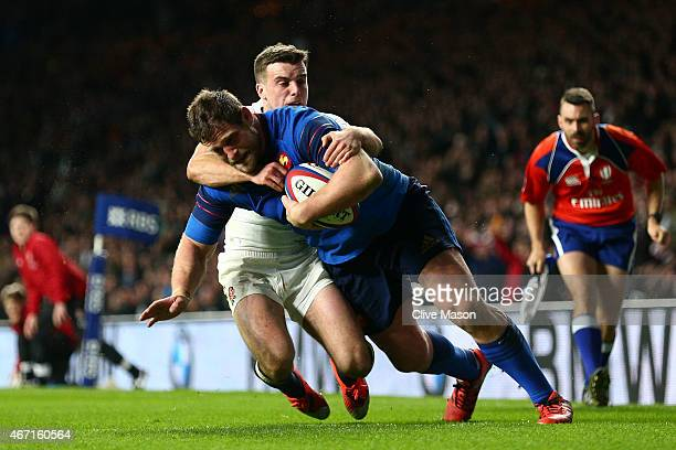 Vincent Debaty of France beats the tackle of George Ford of England to score his team's fourth try during the RBS Six Nations match between England...