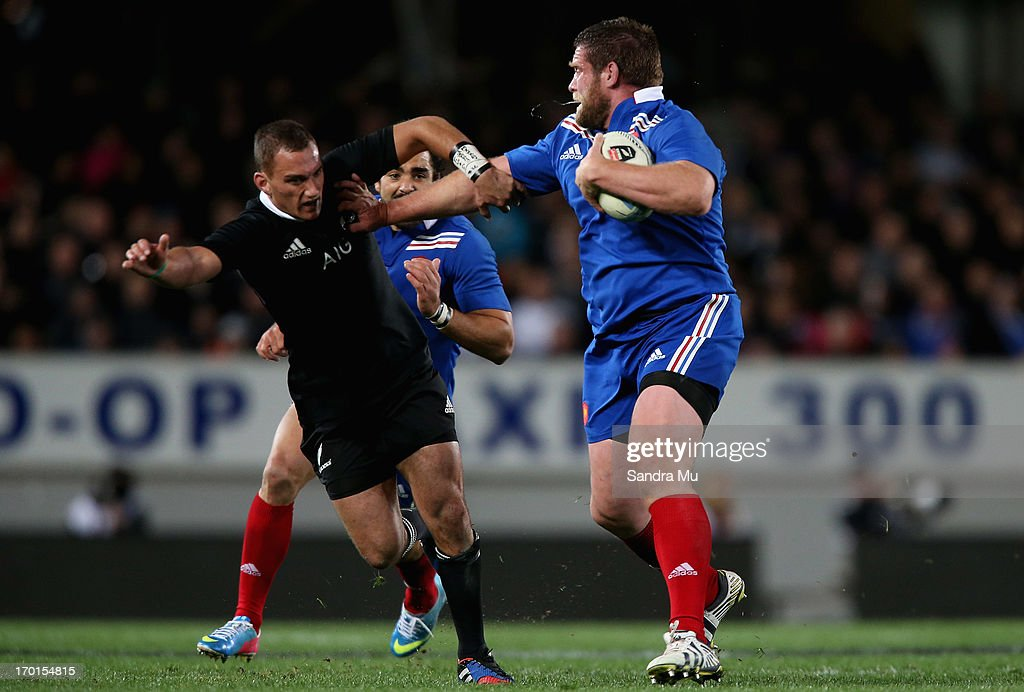 Vincent Debaty of France (R) fends off <a gi-track='captionPersonalityLinkClicked' href=/galleries/search?phrase=Aaron+Cruden&family=editorial&specificpeople=5501441 ng-click='$event.stopPropagation()'>Aaron Cruden</a> of the All Blacks during the first test match between the New Zealand All Blacks and France at Eden Park on June 8, 2013 in Auckland, New Zealand.