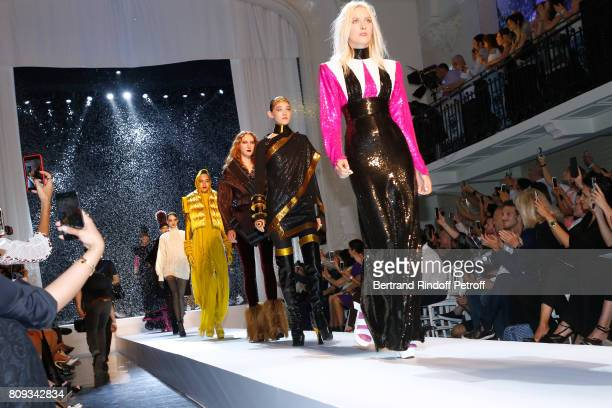 Vincent Dedienne Amanda Lear and Farida Khelfa Seydoux applause Models at the end of the Jean Paul Gaultier Haute Couture Fall/Winter 20172018 show...