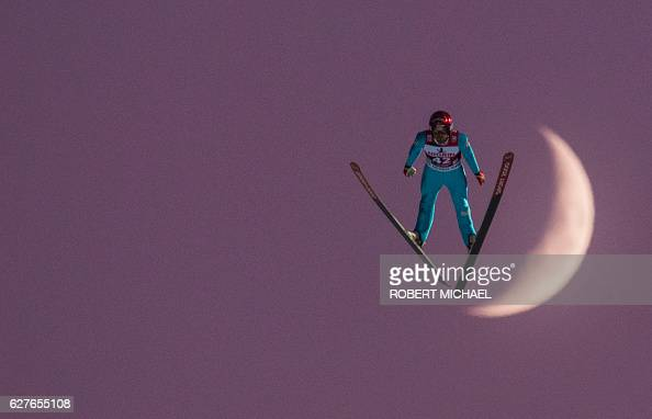 TOPSHOT Vincent Descombes Sevoie of France competes in front of the moon during the FIS Ski Jumping World Cup on December 4 2016 in Klingenthal...