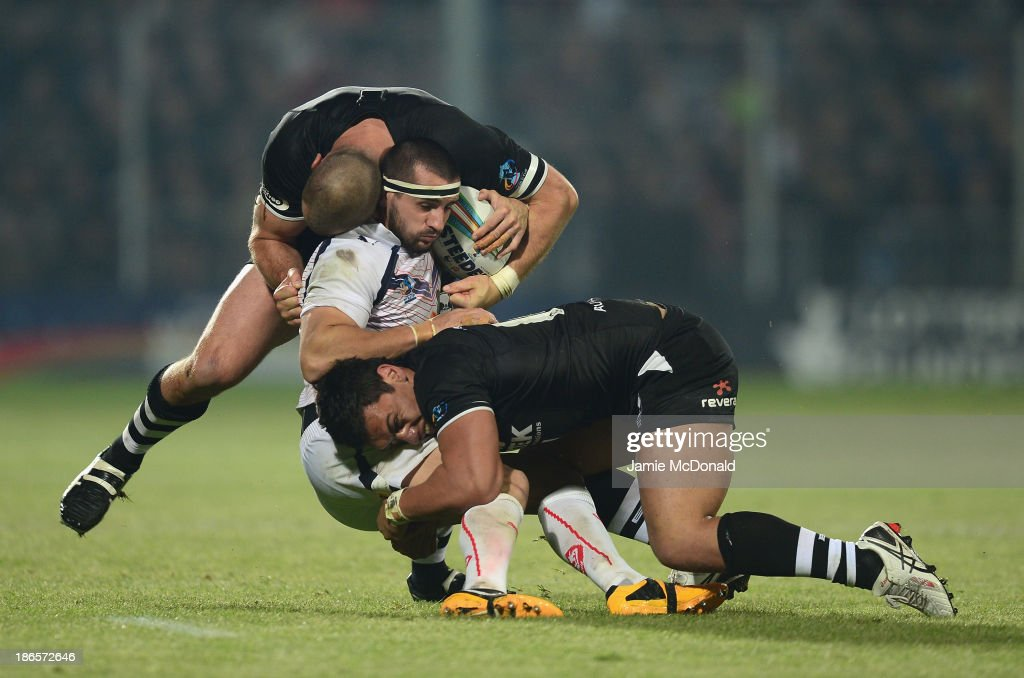 Vincent Duport of France is tackled by Simon Mannering and Alex Glenn of New Zealand during the Rugby League World Cup group B match between New Zealand and France at Parc des Sports on November 1, 2013 in Avignon, France.
