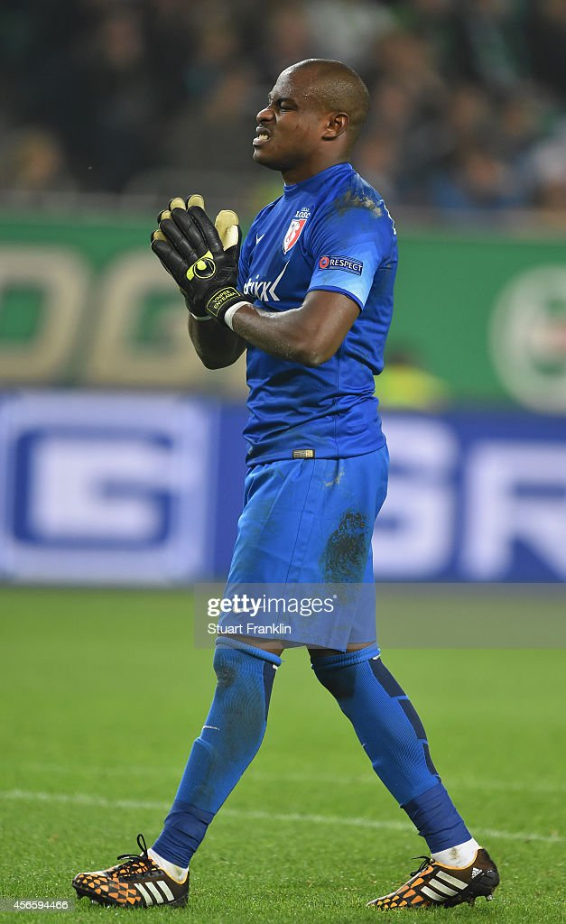 <a gi-track='captionPersonalityLinkClicked' href=/galleries/search?phrase=Vincent+Enyeama&family=editorial&specificpeople=831392 ng-click='$event.stopPropagation()'>Vincent Enyeama</a> of Lille reacts during the UEFA Europa League match between VfL Wolfsburg and LOSC Lille at the Volkswagen Arena on October 2, 2014 in Wolfsburg, Germany.