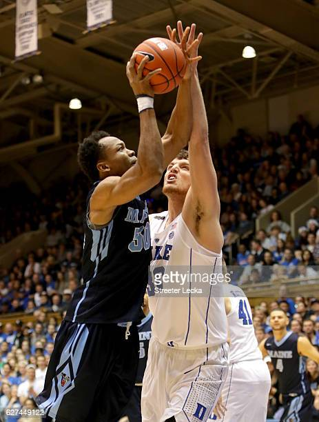 Vincent Eze of the Maine Black Bears drives to the basket against Antonio Vrankovic of the Duke Blue Devils during their game at Cameron Indoor...
