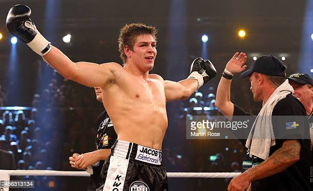 Vincent Feigenbutz of Germany celebrates after winning the WBO Intercontinental Interim Super Middleweight Championship fight at Sparkassen Arena on...