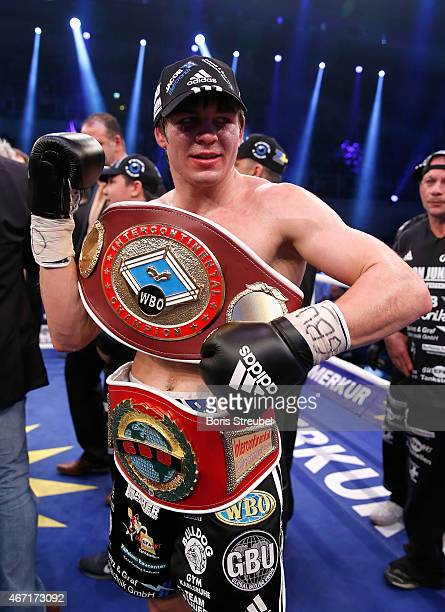 Vincent Feigenbutz of Germany celebrates after winning the WBO intercontinental super middleweight championship fight against Balazs Kelemen of...