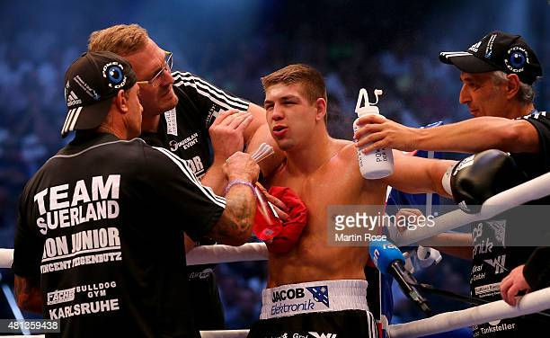 Vincent Feigenbutz of Germany gets instructions during the WBA interim super middleweight championship fight at Gerry Weber Stadium on July 18 2015...