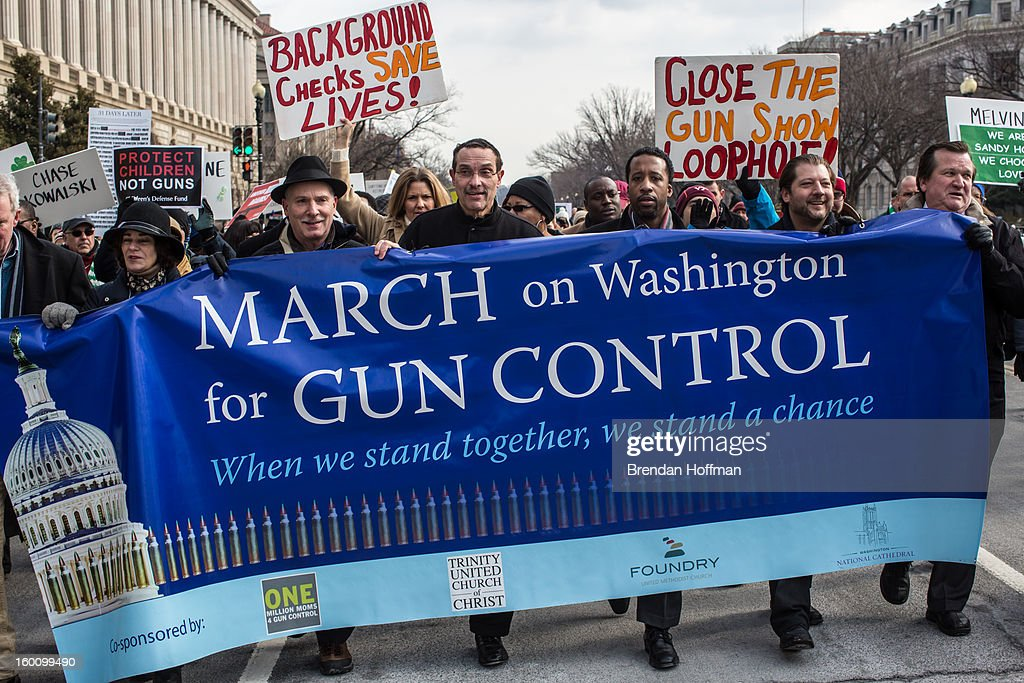 Vincent Gray (C), Mayor of the District of Columbia, leads a march for stricter gun control laws on January 26, 2013 in Washington, DC. The demonstrators included survivors of the shooting at Virginia Tech, Newtown, Connecticut, and others.