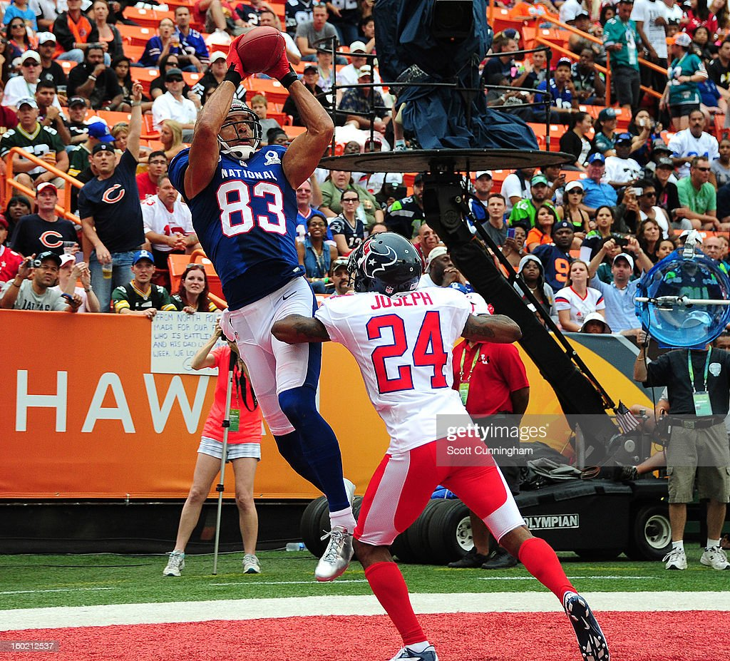 Vincent Jackson #83 of the Tampa Bay Buccaneers and the NFC makes a catch for a touchdown against Johnathan Joseph #24 of the American Football Conference team during the 2013 Pro Bowl at Aloha Stadium on January 27, 2013 in Honolulu, Hawaii