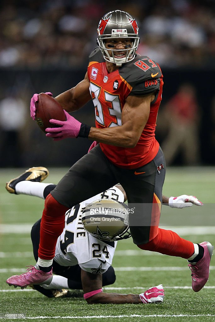 Vincent Jackson of the Tampa Bay Buccaneers avoids a tackle by Corey White of the New Orleans Saints during the second quarter of a game at the...