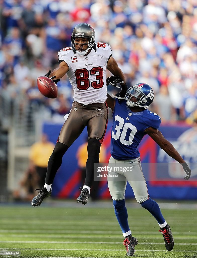 Vincent Jackson of the Tampa Bay Buccaneers can't come up with the ball as he defended by Justin Tryon of the New York Giants at MetLife Stadium on...