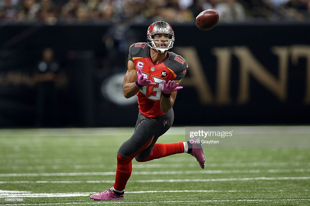Vincent Jackson of the Tampa Bay Buccaneers catches a pass during the fourth quarter of a game against the New Orleans Saints at the MercedesBenz...