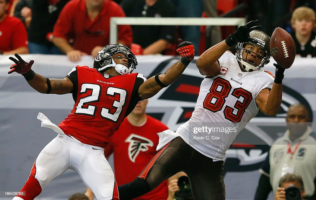 <a gi-track='captionPersonalityLinkClicked' href=/galleries/search?phrase=Vincent+Jackson&family=editorial&specificpeople=763433 ng-click='$event.stopPropagation()'>Vincent Jackson</a> #83 of the Tampa Bay Buccaneers fails to pull in this touchdown reception against <a gi-track='captionPersonalityLinkClicked' href=/galleries/search?phrase=Robert+Alford&family=editorial&specificpeople=6315945 ng-click='$event.stopPropagation()'>Robert Alford</a> #23 of the Atlanta Falcons at Georgia Dome on October 20, 2013 in Atlanta, Georgia.