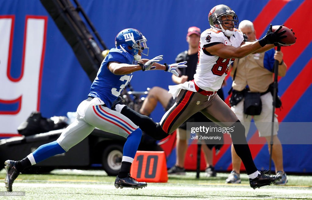 Vincent Jackson of the Tampa Bay Buccaneers makes a catch and runs in for a touchdown in front of Michael Coe of the New York Giants during a game at...