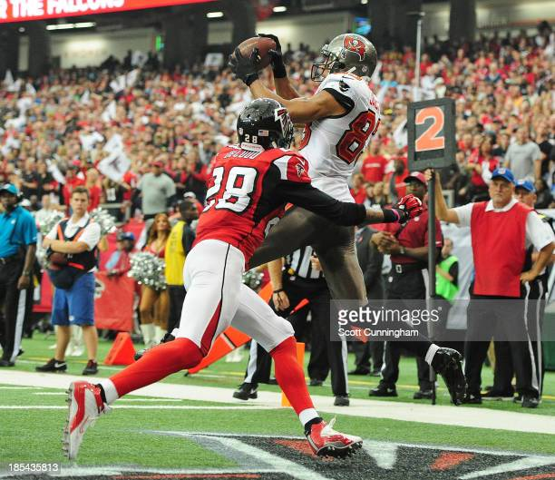 Vincent Jackson of the Tampa Bay Buccaneers makes a catch for a touchdown against Thomas DeCoud of the Atlanta Falcons at the Georgia Dome on October...