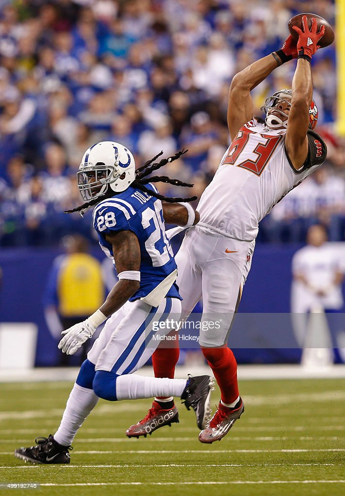 Vincent Jackson of the Tampa Bay Buccaneers reaches for a catch as Greg Toler of the Indianapolis Colts defends at Lucas Oil Stadium on November 29...