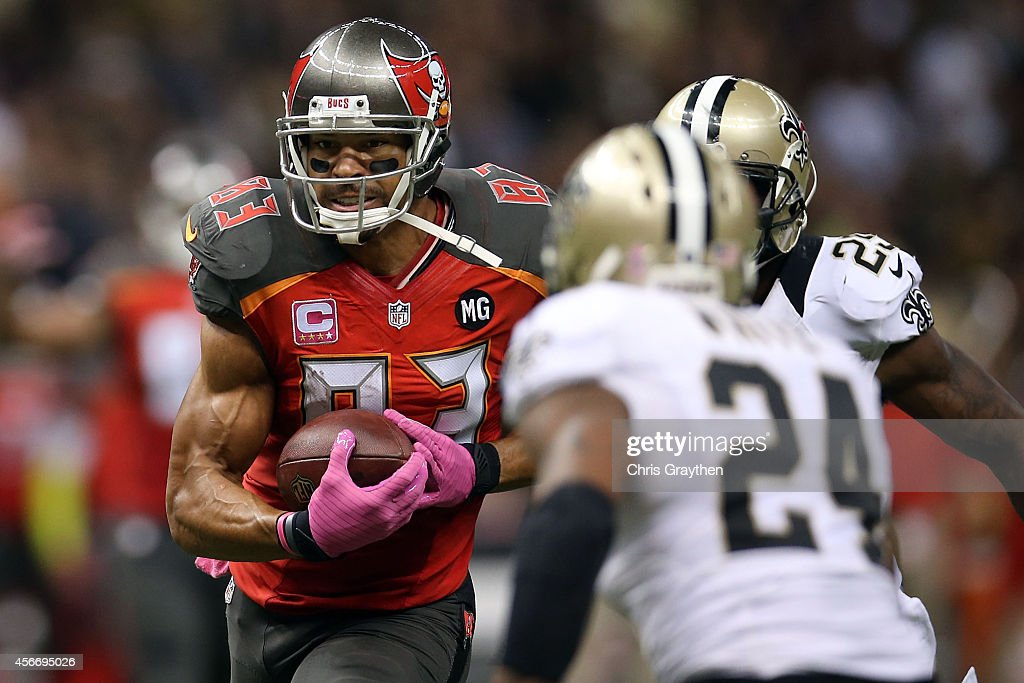 Vincent Jackson of the Tampa Bay Buccaneers tries to avoid Corey White of the New Orleans Saints during the third quarter of a game at the...