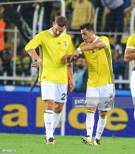 Vincent Janssen and Giuliano De Paulo of Fenerbahce chat at the end of the Turkish Super Lig match between Fenerbahce and Evkur Yeni Malatyaspor at...