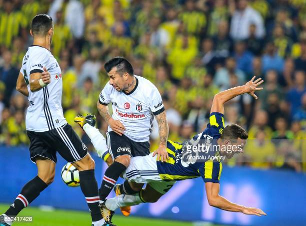 Vincent Janssen of Fenerbahce in action against Gary Medel of Besiktas during the Turkish Super Lig week 6 soccer match between Fenerbahce and...