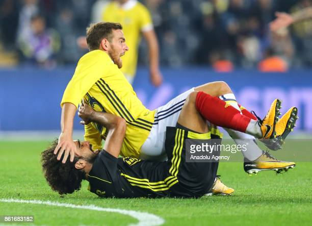 Vincent Janssen of Fenerbahce in action against Sadik Ciftpinar of Evkur Yeni Malatyaspor during the Turkish Super Lig match between Fenerbahce and...