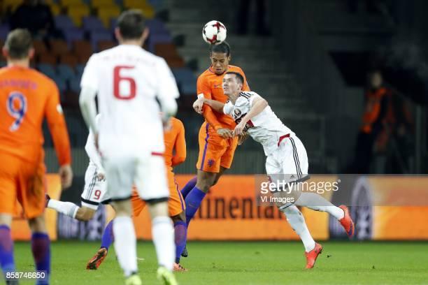 Vincent Janssen of Holland Sergei Politevich of Belarus Virgil van Dijk of Holland Nikolai Signevich of Belarus during the FIFA World Cup 2018...