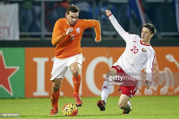 Vincent Janssen of Holland U21 Aleksandr Poznyak of Belarus U21 during the EURO U21 2017 qualifying match between Netherlands U21 and Belarus U21 at...