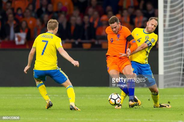 Vincent Janssen of Netherlands and Andreas Granqvist of Sweden battle for the ball during the FIFA 2018 World Cup Qualifier between Netherlands and...