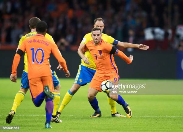 Vincent Janssen of Netherlands and Andreas Granqvist of Sweden competes for the ball during the FIFA 2018 World Cup Qualifier between Netherlands and...