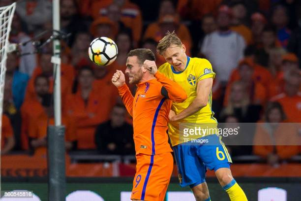 Vincent Janssen of Netherlands and Ludwig Augustinsson of Sweden battle for the ball during the FIFA 2018 World Cup Qualifier between Netherlands and...
