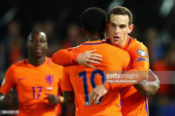 Vincent Janssen of the Netherlands celebrates scoring a goal with Jeremain Lens during the FIFA 2018 World Cup Qualifier between the Netherlands and...