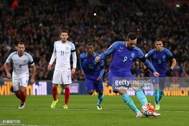 Vincent Janssen of the Netherlands scores his team's first goal from a penalty kick during the International Friendly match between England and the...