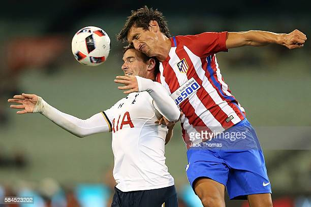 Vincent Janssen of Tottenham and Stefan Savic of Atletico Madrid compete for the ball during 2016 International Champions Cup Australia match between...