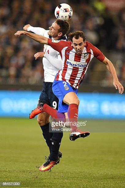 Vincent Janssen of Tottenham Hotspur headers the ball against Diego Godin of Atletico de Madrid during 2016 International Champions Cup Australia...