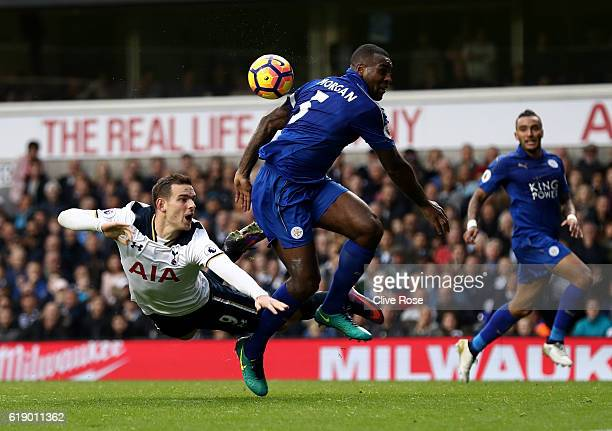 Vincent Janssen of Tottenham Hotspur heads towards goal while Wes Morgan of Leicester City attempts to block during the Premier League match between...