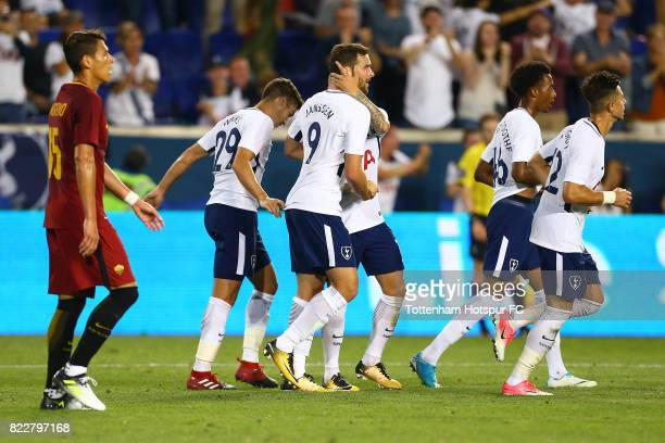 Vincent Janssen of Tottenham Hotspur is mobbed by teamates after scoring a goal late in the second half against Roma during the International...
