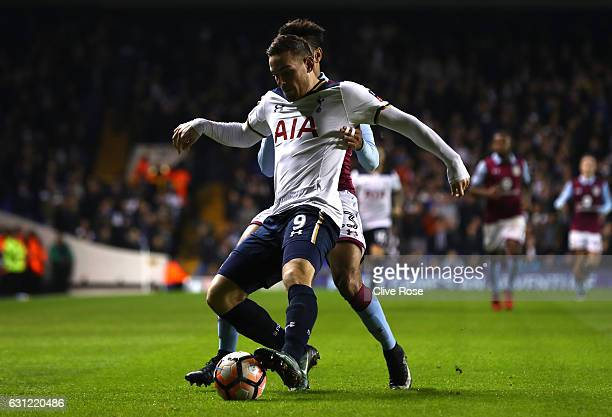 Vincent Janssen of Tottenham Hotspur is put under pressure during The Emirates FA Cup Third Round match between Tottenham Hotspur and Aston Villa at...