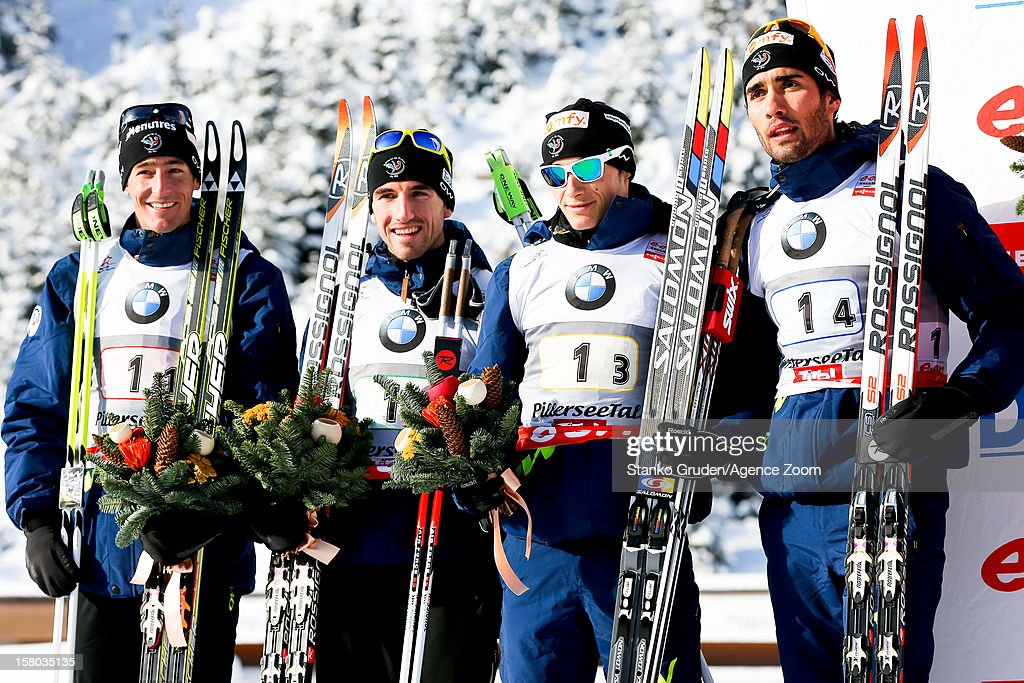 Vincent Jay, Jean Guillaume Beatrix, Alexis Boeuf, Martin Fourcade of France takes 2nd place during the IBU Biathlon World Cup Men's Relay on December 09, 2012 in Hochfilzen, Austria.