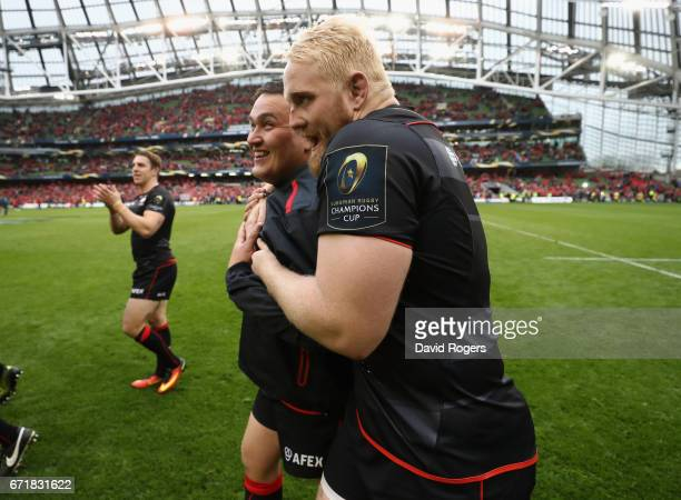 Vincent Koch of Saracens celebrates with team mate Jamie George after their victory during the European Rugby Champions Cup semi final match between...