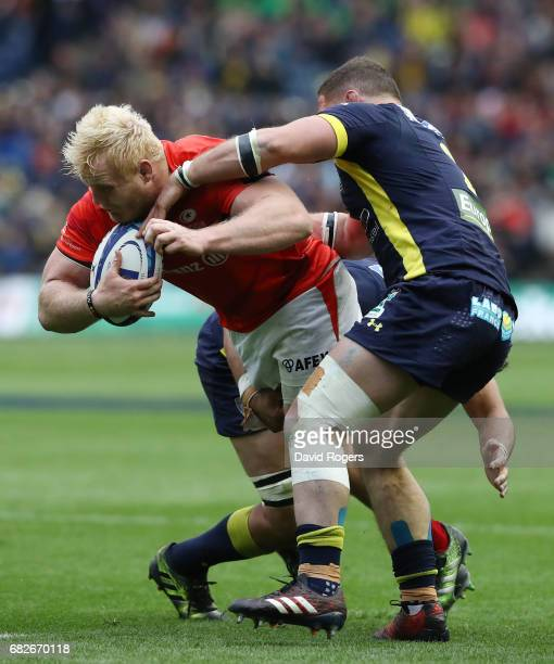 Vincent Koch of Saracens is tackled by Benjamin Kayser of Clermont Auvergne during the European Rugby Champions Cup Final between ASM Clermont...