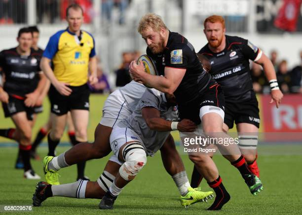 Vincent Koch of Saracens is tackled by Taulupe Faletau and Ben Tapuai during the Aviva Premiership match between Saracens and Bath at Allianz Park on...
