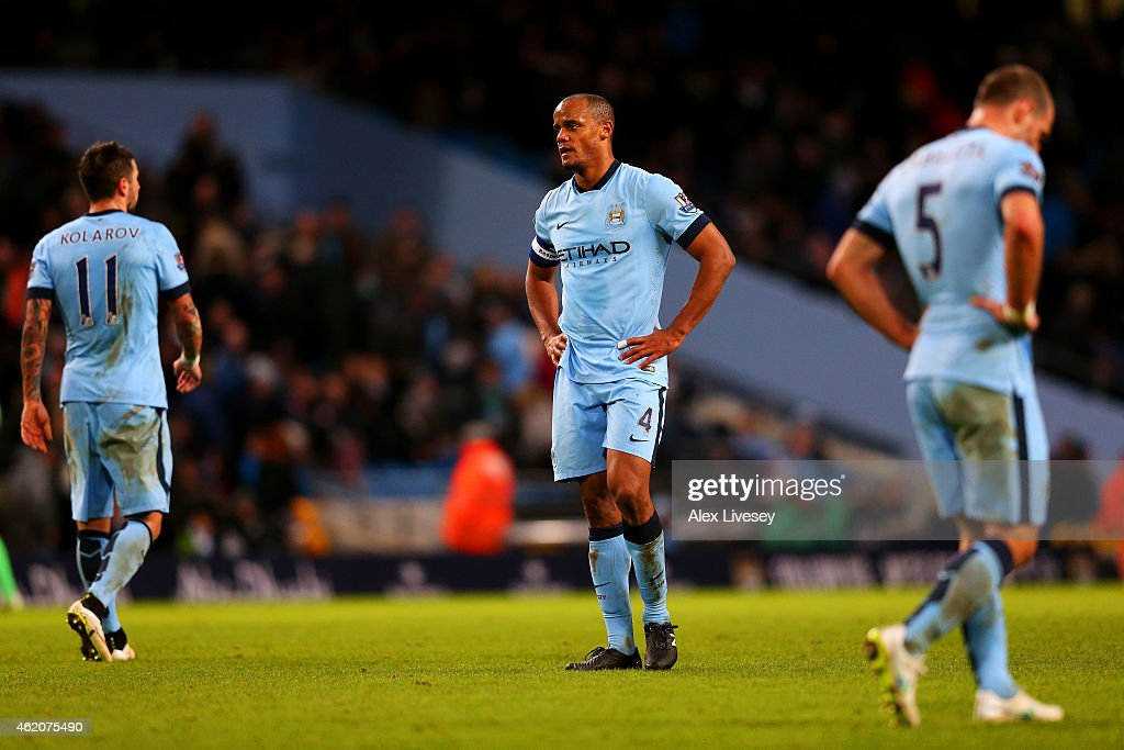 <a gi-track='captionPersonalityLinkClicked' href=/galleries/search?phrase=Vincent+Kompany&family=editorial&specificpeople=504694 ng-click='$event.stopPropagation()'>Vincent Kompany</a> (C), <a gi-track='captionPersonalityLinkClicked' href=/galleries/search?phrase=Aleksandar+Kolarov&family=editorial&specificpeople=4329824 ng-click='$event.stopPropagation()'>Aleksandar Kolarov</a> (L) and Pablo Zabaleta of Manchester City show their dejection after conceding a goal during the FA Cup Fourth Round match between Manchester City and Middlesbrough at Etihad Stadium on January 24, 2015 in Manchester, England.