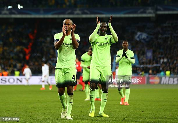 Vincent Kompany and Yaya Toure of Manchester City applaud the travelling fans following their team's 31 victory during the UEFA Champions League...