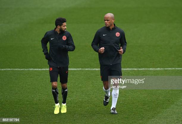 Vincent Kompany chats with Gael Clichy during a Manchester City training session prior to the UEFA Champions League Round of 16 Second Leg match...