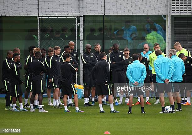Vincent Kompany joins team mates for a huddle during a Manchester City training session ahead of their Champions League fixture against Borussia...