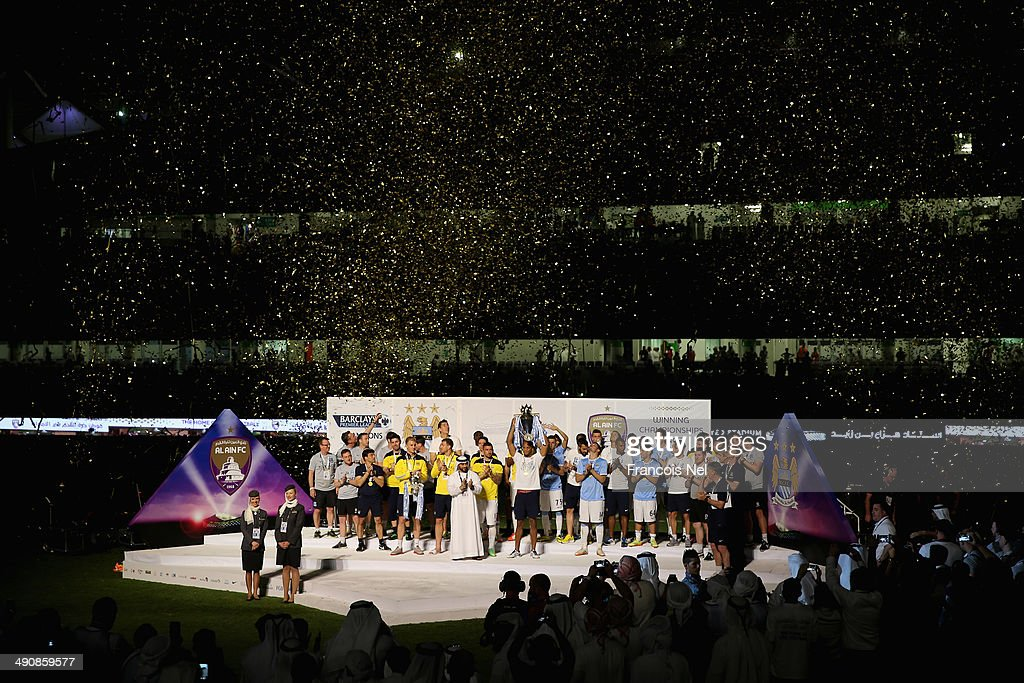Vincent Kompany lifts the throphy after the friendly match between Al Ain and Manchester at Hazza bin Zayed Stadium on May 15, 2014 in Al Ain, United Arab Emirates.